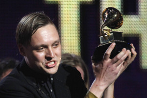 "Edwin Butler of Canadian band Arcade Fire holds up the Grammy for Album of the Year for ""The Suburbs"" at the 53rd annual Grammy Awards in Los Angeles"